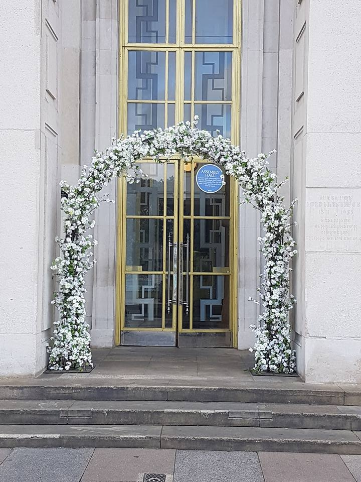 Wedding arch hire framing an entrance